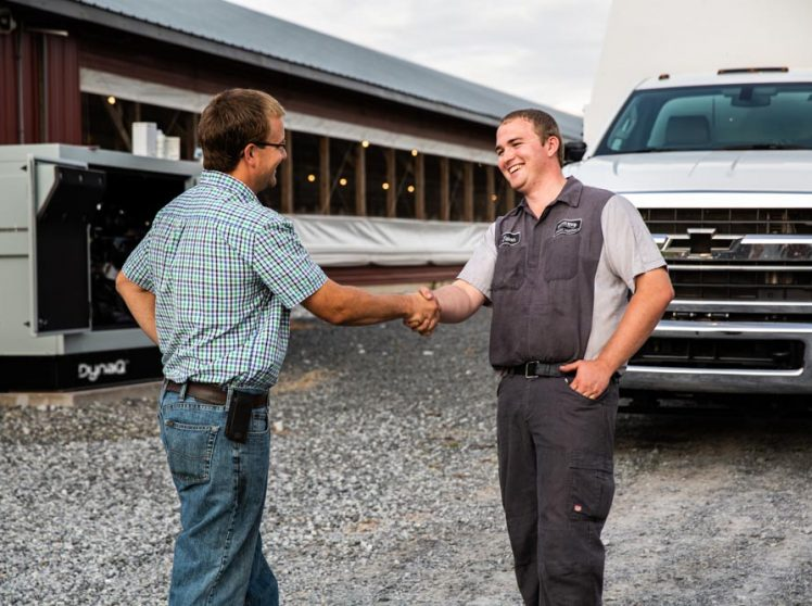 Thankful business owner shaking hands with experienced tech