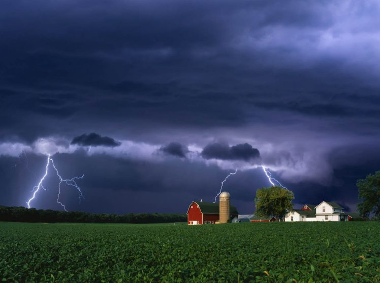 Flashes of lightning over a farm